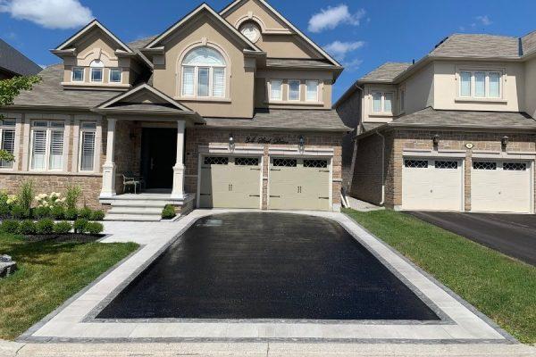 Single-house-two-garage-asphalt-sealing-driveway