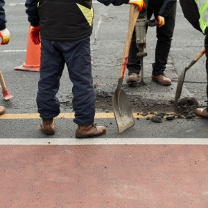 Image depicts our experts repairing asphalt in a driveway.