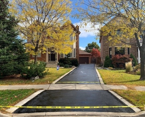 Image depicts a residential driveway that has been sealed.