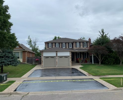 Image depicts a Richmond Hill home with a driveway that has been sealed.