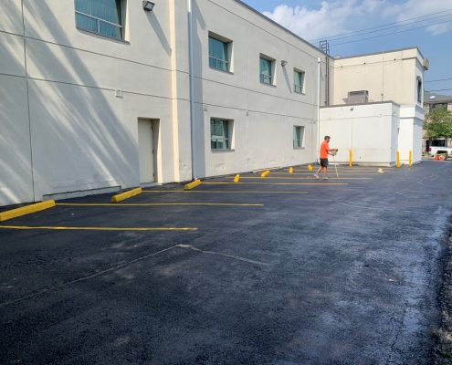 Image depicts a commercial parking lot with newly painted traffic lines.