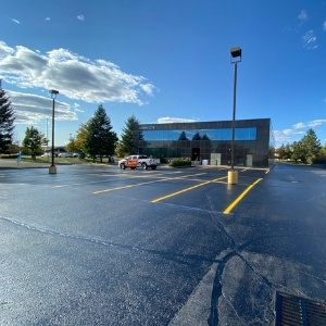 Image depicts a parking lot with newly painted traffic lines.