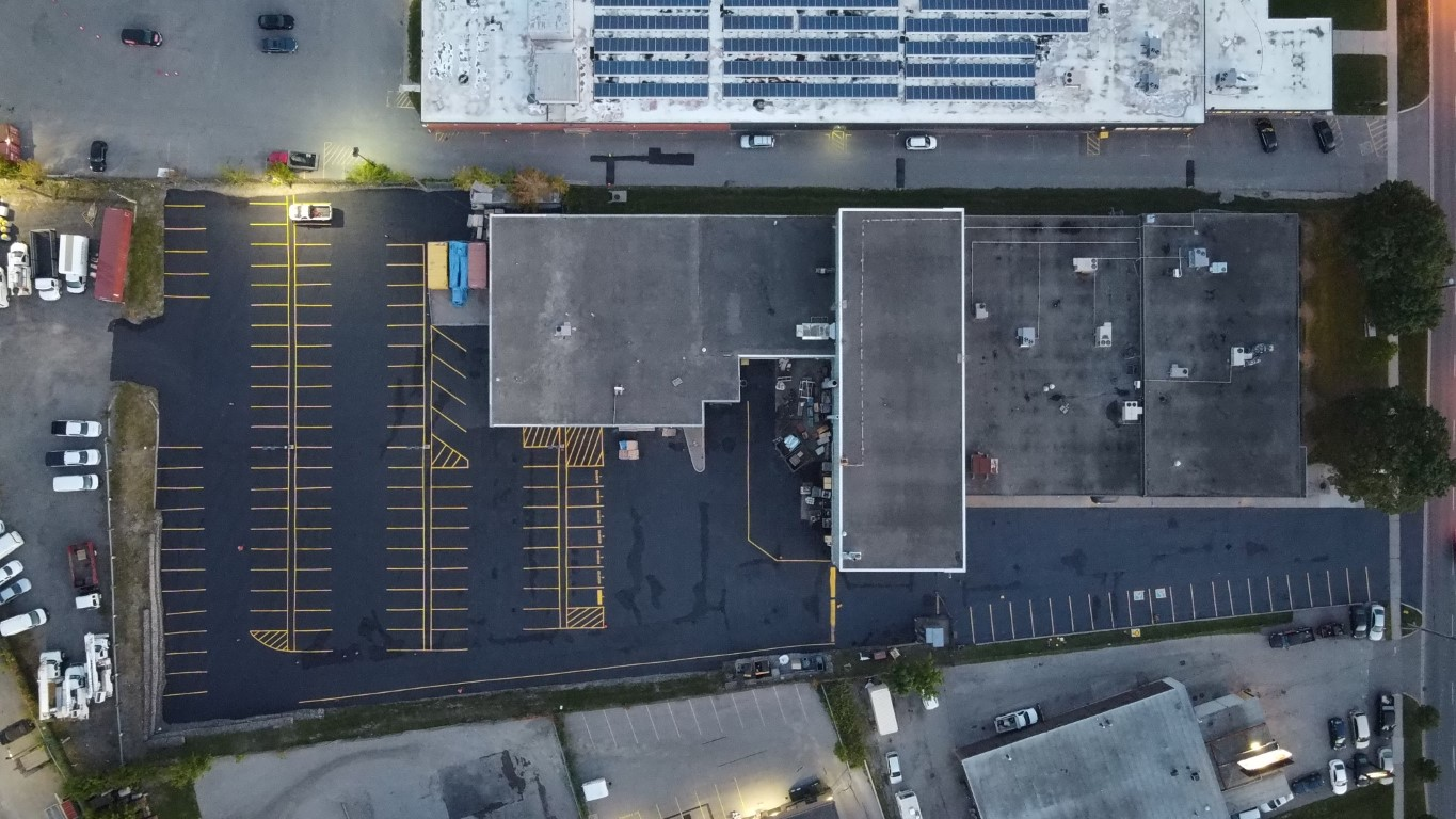Commercial property with newly painting lines and sealed asphalt.