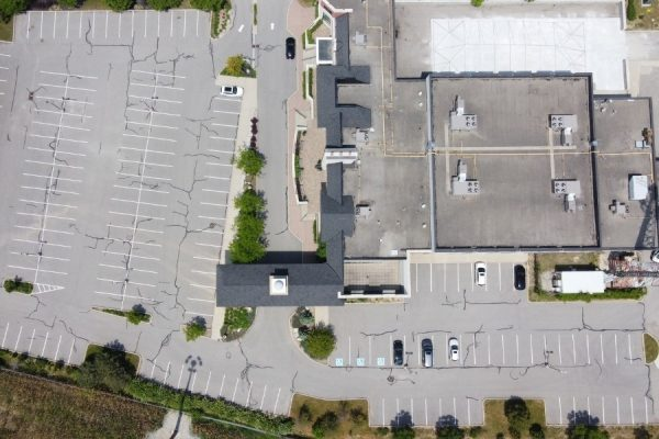 Image depicts an image of a commercial parking lot from a asphalt crack sealing and line painting project by AHS.