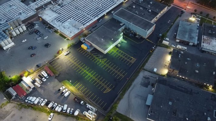 Commercial parking lot with sealed asphalt and new line painting.