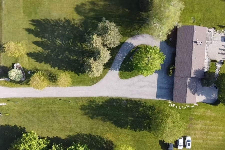Image depicts a residential driveway from a residential asphalt sealing project in Aurora by AHS.